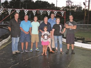 """TROPHY WINNERS AT AUGUST 23 RACE — The Harbinson & Brzykcy Race Team won the """"Race Against Hunger"""" on August 23, 2016, at Pollard Raceway, outrunning the East Taylorsville Baptist Church Race Team. The winning team included, Larry Pollard (Track Owner), Robin Harris, Daniel Odom, Joel Harbinson, Payton Seitz (Harris' grandaughter), Mark Odom, Anna Harris, Justin Harbinson, and David Odom (not pictured). Three more events in the """"Race Against Hunger"""" series are scheduled for upcoming Tuesday nights featuring various race teams to benefit different local food ministries."""