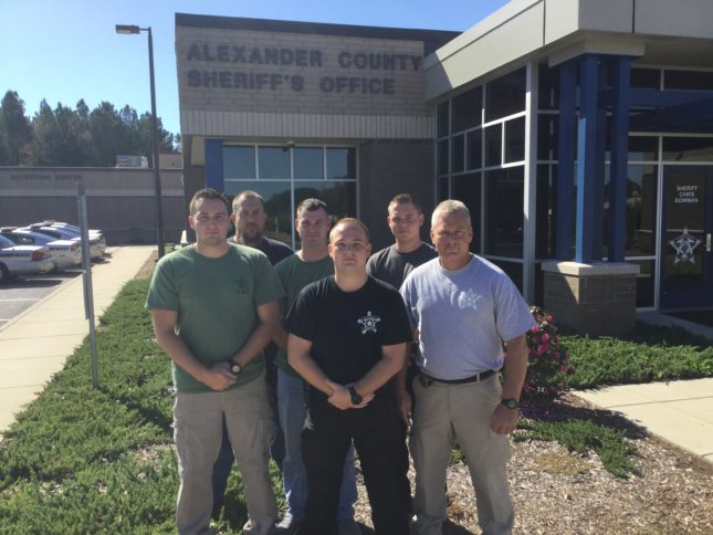Pictured above, L-R: Alexander County Sheriff's Office members Dep. Heath Pennell, SGT. Timothy Simms, Dep. Lee Hoyle, Dep. Chase Little, Dep. Jordan Barnes, Dep. Mike Bruce will be assisting Robeson County Sheriff's deputies with patrol after flooding and damage from Hurricane Matthew.