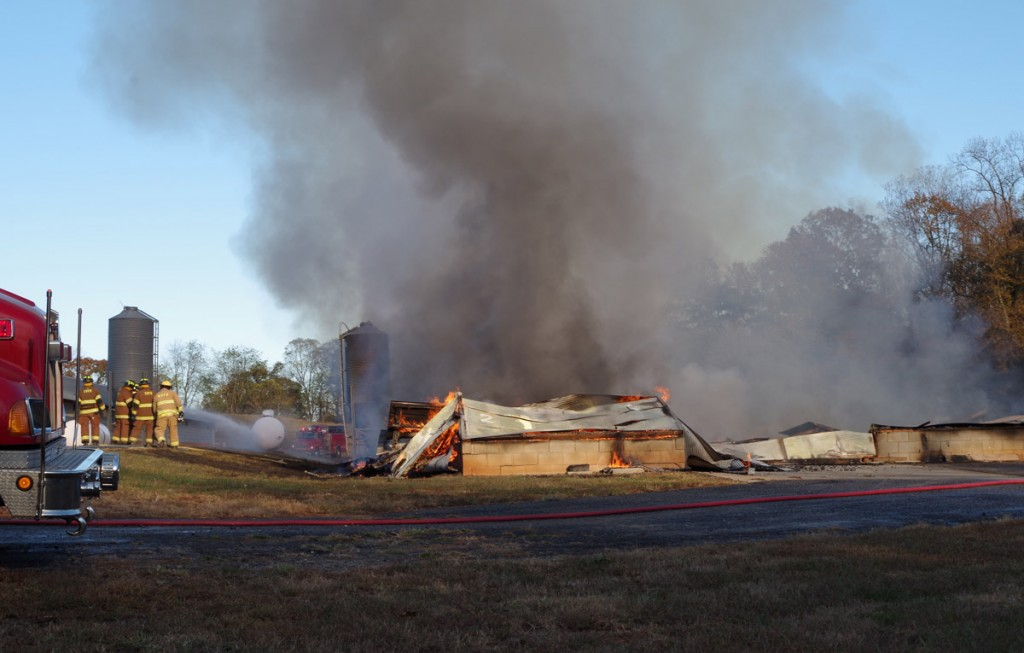 Firefighters are shown on the scene of a chicken house fire on Arthur Jenkins Lane in Taylorsville on Monday, Nov. 7, 2016.