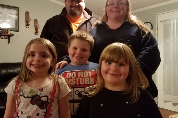 FAMILY'S HOME DESTROYED — The Stony Point home of Timothy and Jennifer Waldrup, was destroyed by fire on Dec. 30. The parents are shown above with their three children: MacKenzie, Jeremiah, and Rebecca. A fund has been started to assist the family, who had no fire insurance. (GoFundMe.com photo)