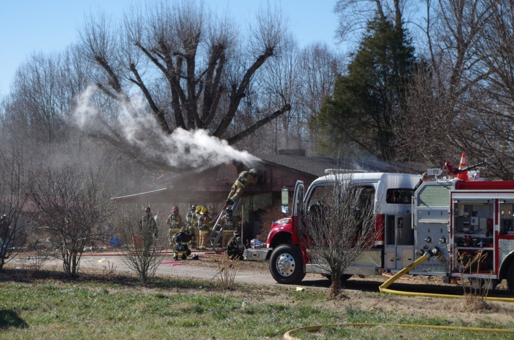 Firefighters work to extinguish a house fire on Drumstand Rd. Dec. 30.