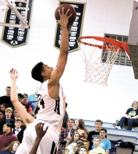 CROWD PLEASER - ACHS senior Justin Dula goes high above the rim to slam a rebounded shot during Tuesday's one point win over the Statesville Greyhounds in Taylorsville.