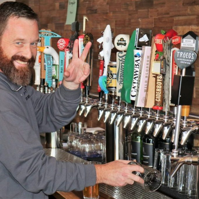 Co-owner Ken Young mans the taps at Brushy Mountain Brews, which opened Jan. 23, 2020, in downtown Taylorsville.