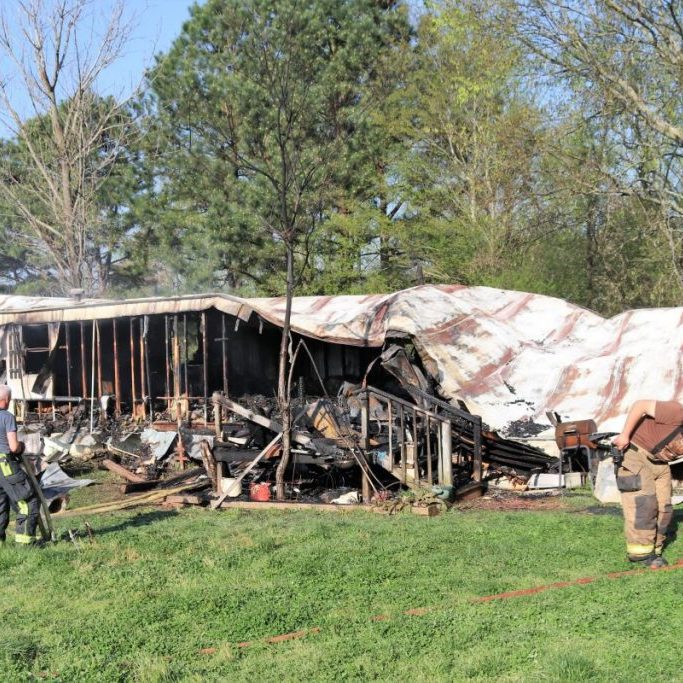 BODY FOUND INSIDE BURNED HOME — Officers and firefighters found this home fully involved in flames early April 7. A body, as yet unidentified, was found inside.