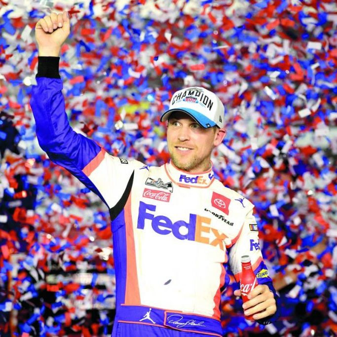 Denny Hamlin, driver of the #11 FedEx Express Toyota, celebrates in Victory Lane after winning the NASCAR Cup Series 62nd Annual Daytona 500 at Daytona International Speedway on February 17, in Daytona Beach, Florida. Chris Graythen | Getty Images