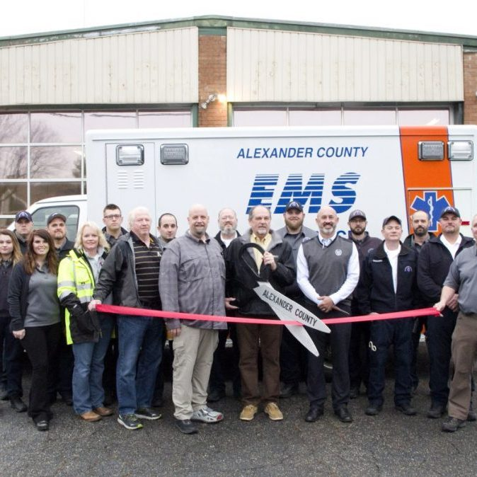 HOUSED IN FORMER FIRE DEPARTMENT — A ribbon cutting was held on Friday, January 3, 2020, for the new Alexander Co. Emergency Medical Services (EMS) Station #3, located in the former Sugar Loaf Fire Department building next to Sugar Loaf Elementary School on NC 16 North. Pictured above, left to right: front row – EMT Kaitlyn Johnson, Admin. Ashlee Patterson, Admin. Melanie Millsaps, County Manager Rick French, EMS Director Doug Gillispie, Commissioner Ronnie Reese, Commissioner Marty Pennell, Training Captain Kevin Richards, Major Jeff Sigmon, EM Planner Mark Howell; back row – Lt Chris Helderman, Paramedic Philip McCurdy, Paramedic Dalton Sweat, Paramedic Trey Sinker, Lt Lewis Armentrout, Field Training Officer Ethan Fox, Paramedic Jacob Cinnamon, FTO Stephen Estes, Deputy Fire Marshal Mark Earle.