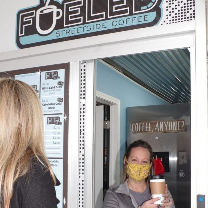 COFFEE WINDOW OPENS — Fueled Streetside Coffee opened on Monday, January 18, at 69 East Main Avenue in the InLine Designs shop, next to Town & Country Drugs. Above, owner Heather Mull Cox prepares coffee for a customer.