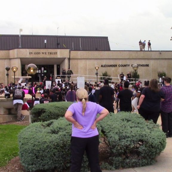 LARGE CROWD — Approximately 250 people turned out for the June 4 protest at Alexander County Courthouse. Multiple law enforcement agencies were situated throughout the downtown area to keep the peace.