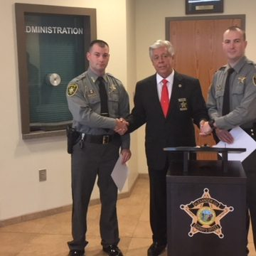Appearing left to right: Deputy Lee Hoyle, Sheriff Chris Bowman, and Deputy Davey Fortner.
