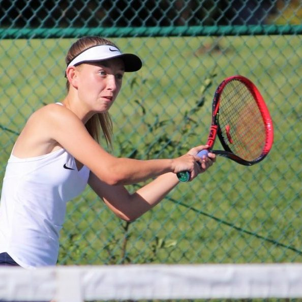 Top seed Kristin Ratliff returns a shot vs. Freedom on court one September 18.
