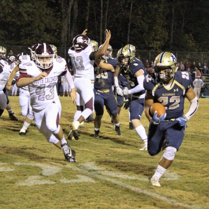 Alexander Central's Tevin Clark rumbles for good yards vs. South Caldwell Friday night.