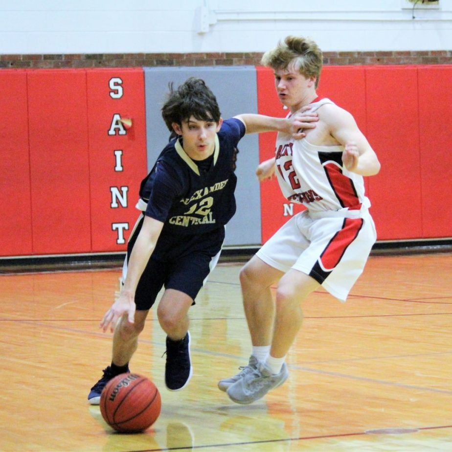 Alexander's Luke Johnson drives past a St. Stephens during Tuesday's JV hoops game in Hickory.