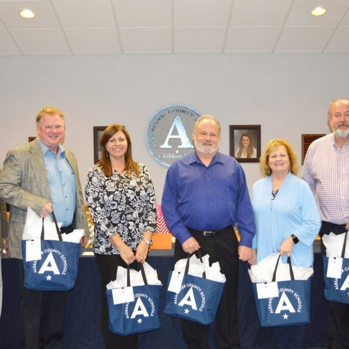 SCHOOL BOARD APPRECIATION — School board members were recognized during the Board of Education meeting Jan. 14 for School Board Appreciation Month. Pictured above, from left: board members David Odom,  Matt Cooksey, Brigette Rhyne, Harry Schrum, Cindy Sellers, and  Scott Bowman. Not pictured: member Caryn Brzykcy.